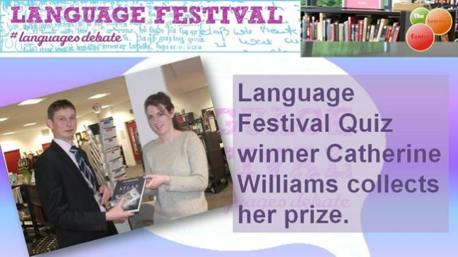 The winner of the Language Festival Quiz collects her prize.