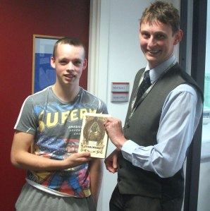 Ben being presented with his prize