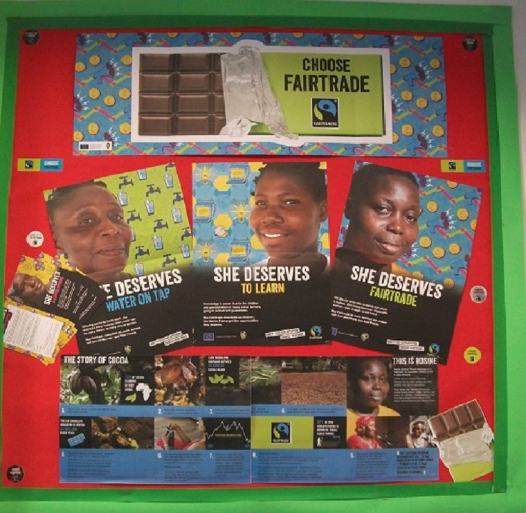 The Library's 'Fairtrade' display. Including the Fairtrade posters 'She Deserves to Learn' and 'She Deserves Water on Tap'.