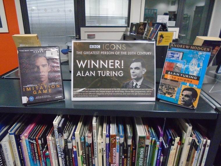 Shelf top display for the BBCs Icons, 'The Greatest Person of the 20th Century', winner Alan Turing. Including the DVD 'The Imitation Game' and Andrew Hodges' book 'Alan Turing the Enigma'.